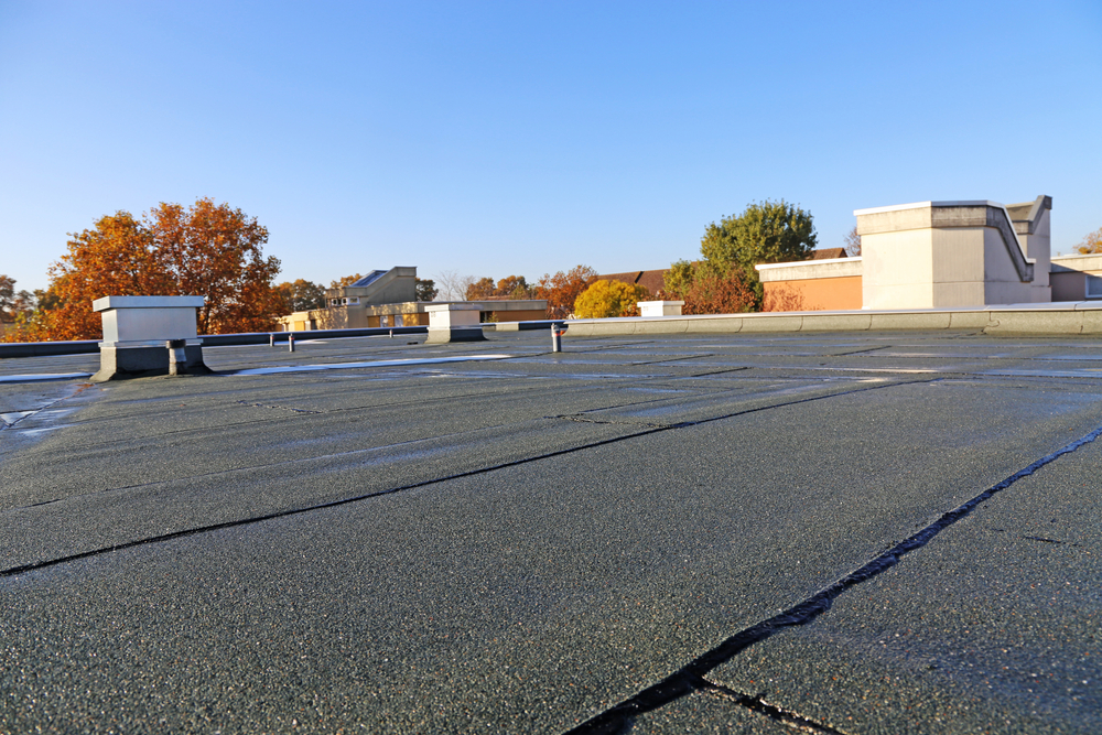 How To Clean A Flat Roof Effectively - Home-Pro Roofing